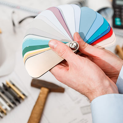 A person hold color swatches.